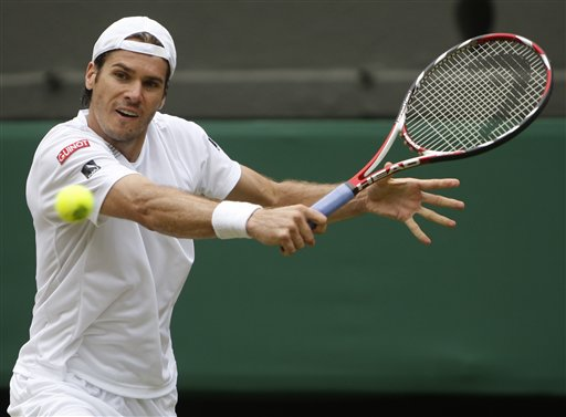 Tommy Haas of Germany returns to Roger Federer of Switzerland during their semi-final match on centre court at Wimbledon on Friday, July 3, 2009. (AP Photo)