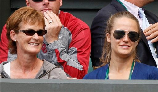 Andy Murray's mother Judy, left, and girlfriend Kim Sears, wait for the start of the men's singles semi-final between Murray and Andy Roddick, on the Centre Court at Wimbledon on Friday, July 3, 2009. (AP Photo)