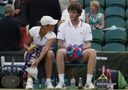 Jamie Murray of Britain, right and Liezel Huber of US during their doubles match on centre court at Wimbledon on Friday, July 3, 2009. (AP Photo)