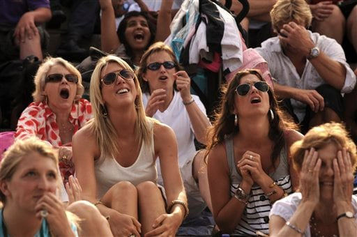 Tennis fans watching a giant screen on court No. 1 reacts as Andy Murray of Britain lose to Andy Roddick of US in their semi-final singles match at Wimbledon on Friday, July 3, 2009. (AP Photo)
