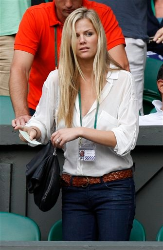 Andy Roddick's wife Brooklyn Decker, arrives for the start of the men's singles semi-final between Britain's Andy Murray and Roddick, on the Centre Court at Wimbledon on Friday, July 3, 2009. (AP Photo)