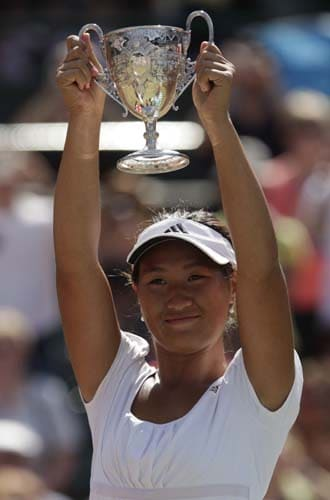 Thailand's Noppawan Lertcheewakarn holds the trophy after winning against France's Kristina Mladenovic during their doubles match at Wimbledon at the All England Club. (AFP Photo)