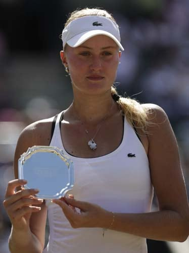 France's Kristina Mladenovic holds the runners up trophy after loosing to Thailand's Noppawan Lertcheewakarn their doubles match at Wimbledon at the All England Club. (AFP Photo)