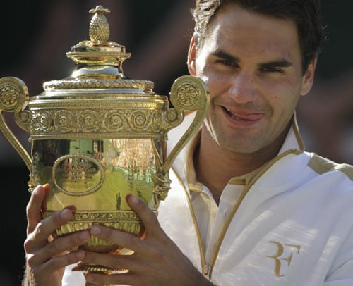 Switzerland's Roger Federer holds the trophy after defeating US' Andy Roddick in their men's final match on the Centre Court at Wimbledon. (AP Photo)