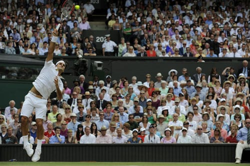 Switzerland's Roger Federer serves a ball to US' Andy Roddick during their final match on the Centre Court at Wimbledon. (AFP Photo)