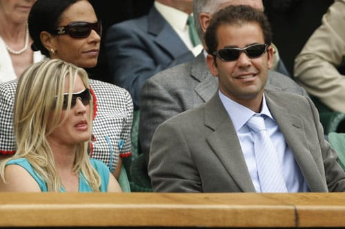 Former champion Pete Sampras and his wife Bidgette watch the men's singles final between Roger Federer of Switzerland and Andy Roddick of the US, on the Centre Court at Wimbledon. (AP Photo)