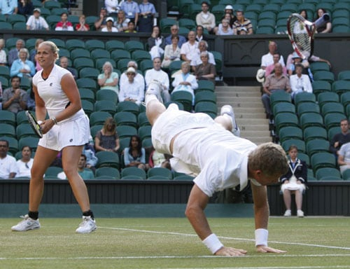 Germany's Anna-Lena Groenefeld watches as her partner Mark Knowles throws himself at a shot, during their mixed doubles final against India's Leander Paes and Zimbabwe's Cara Black on the Centre Court at Wimbledon. (AP Photo)