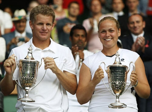 Germany's Anna-Lena Groenefeld and her partner Mark Knowles of the Bahamas pose with their trophies after winning their mixed doubles final against India's Leander Paes and Zimbabwe's Cara Black on the Centre Court at Wimbledon. (AP Photo)