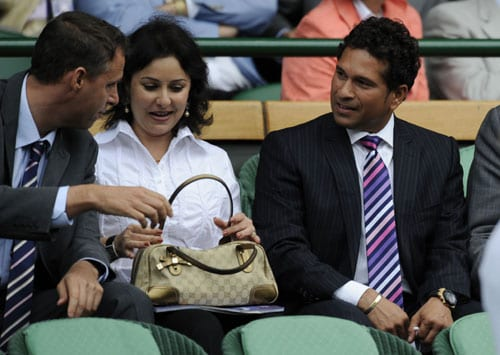 Indian cricketer Sachin Tendulkar and his wife Anjali attend the men's final tennis match between Switzerland's Roger Federer and US' Andy Roddick on the Centre Court at Wimbledon. (AP Photo)
