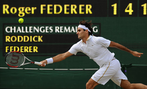 Switzerland's Roger Federer plays against US' Andy Roddick in the Men's Singles final match on the Centre Court at Wimbledon. (AFP Photo)