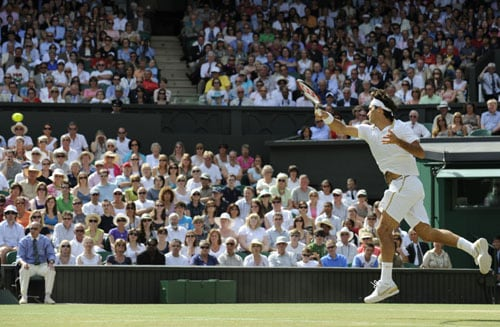 Switzerland's Roger Federer returns a ball to US' Andy Roddick during their final match on the Centre Court at Wimbledon. (AFP Photo)
