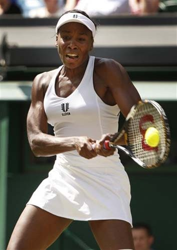 Venus Williams of USA plays a return to Carla Suarez Navarro of Spain during their third round match at the 2009 Wimbledon. (AP Photo)