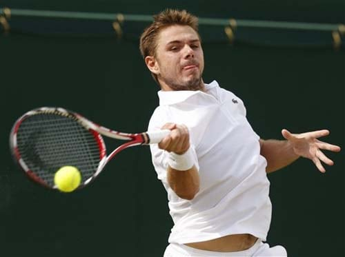 Stanislas Wawrinka of Switzerland plays a return to Jesse Levine of USA during their third round singles match at the 2009 Wimbledon. (AP Photo)