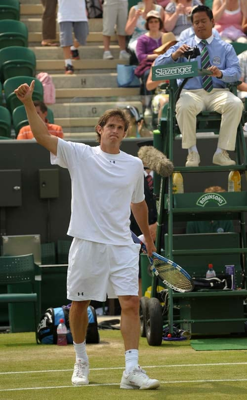 Russia's Igor Andreev celebrates after beating Italy's Andreas Seppi 6-1, 7-6, 4-6, 7-6, in the third round men's singles match on the sixth day of the 2009 Wimbledon. (AFP PHOTO)