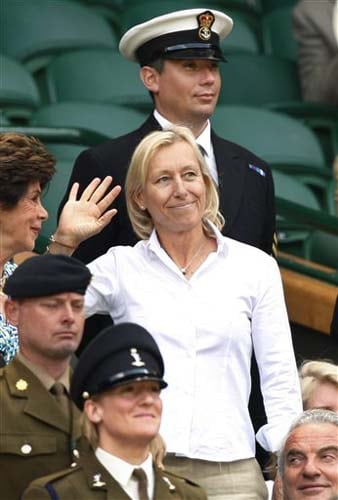 Martina Navratilova, 9 times Wimbledon singles champion waves from the Royal Box on centre court prior to a third round singles match on the sixth day of the 2009 Wimbledon. (AP Photo)