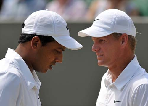 India's Mahesh Bhupathi partners Mark Knowles of Bahamas' in a Men's Doubles Quarter Final match against South Africa's Wesley Moodie and Belgium's Dick Norman on Day 9 at the 2009 Wimbledon at the All England Club. (AFP Photo)