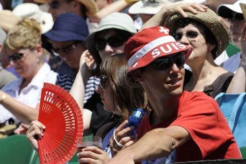 A Swiss tennis fan attends a tennis match between Roger Federer and Croatia's Ivo Karlovic during their quarter Final match on Day 9 at the 2009 Wimbledon at the All England Club. (AP Photo)