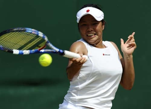 Japan's Akiko Omae returns a ball to France's Kristina Mladenovic during their girls match on Day 9 at the 2009 Wimbledon at the All England Club. (AFP Photo)