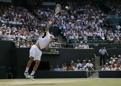 Germany's Tommy Haas serves against Serbia's Novak Djokovic in a Men's Quarter Final match on Day 9 at the 2009 Wimbledon at the All England Club. (AFP Photo)