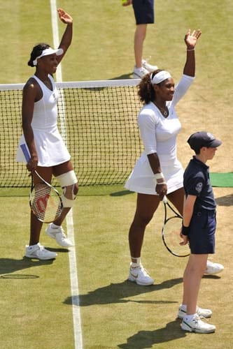 US' Serena Williams and US' Venus Williams wave after winning against Anna-Lena Groenefeld and US' Vania King during their doubles match on Day 9 at the 2009 Wimbledon at the All England Club. (AFP Photo)
