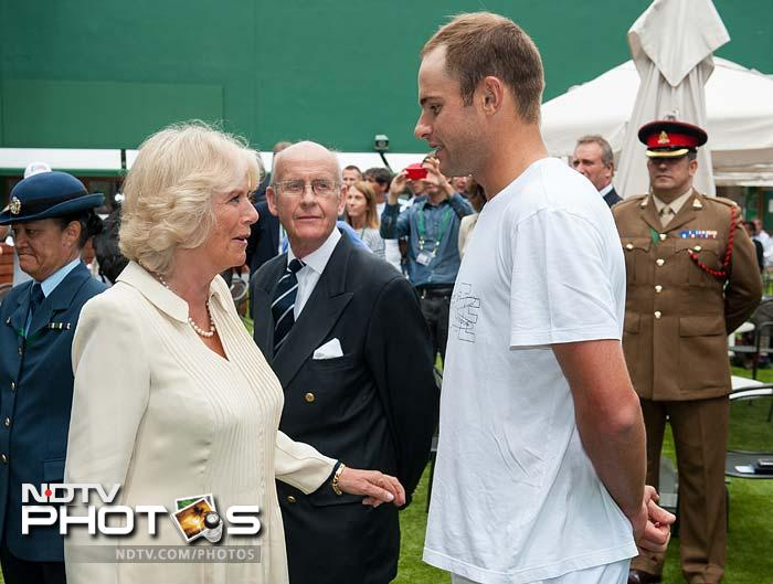 Camilla, who arrived before Prince Charles at the All England Club, met and chatted with Andy Roddick.