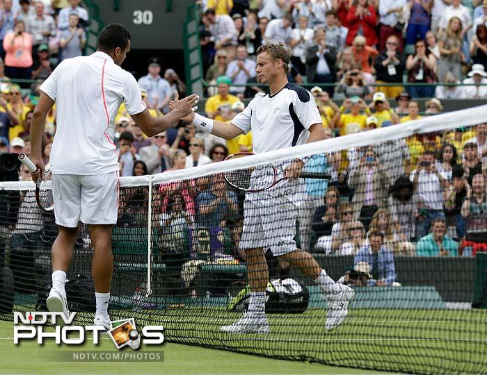Lleyton Hewitt's 10th anniversary party of his 2002 Wimbledon title was gatecrashed by French fifth seed Jo-Wilfried Tsonga who cruised to a 6-3, 6-4, 6-4 win.