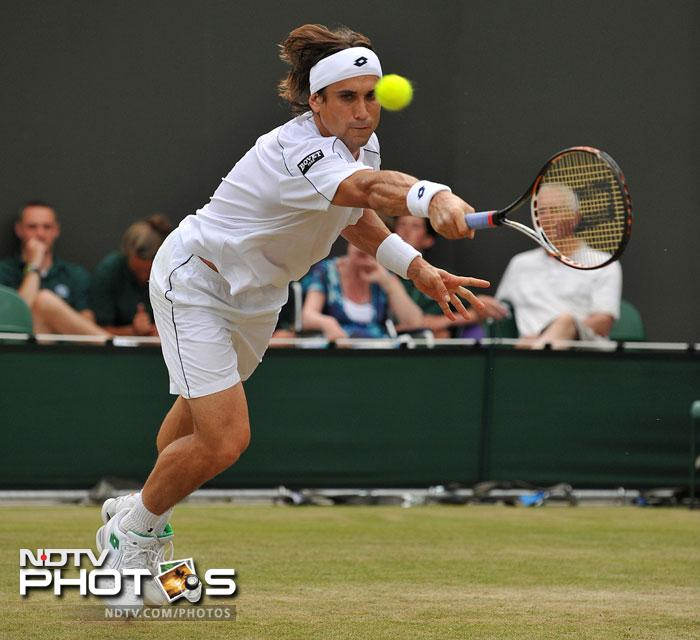David Ferrer is widely experienced and immensely hard-working but Wimbledon has never been his forte. He though reached the quarters in 2012. Although an impressive performance at the French Open, reaching the final, might boost the 31-year old, grass could prove to be too much for his style of play. (AFP Photo)