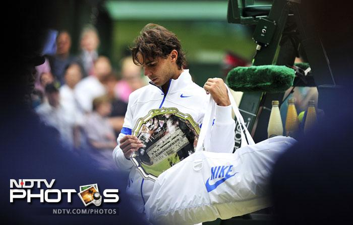 Rafael Nadal may have been beaten by an in-form Djokovic at the Wimbledon 2011, but Rafa is not one who takes anything lying down. The French Open 2012 and 2013 proved that he still has all the firepower required to trump difficult opponents. Rafa would definitely be looking for a 2008 and 2010 encore at the championships. (AFP Photo)