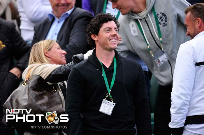Northern Irish golf player Rory McIlroy stands in the crowd to watch his girlfriend Denmark's Caroline Wozniacki play against Spain's Estrella Cabeza Candela.<br><br>Wozniacki however crashed out on day three. She lost to Petra Cetkovska.