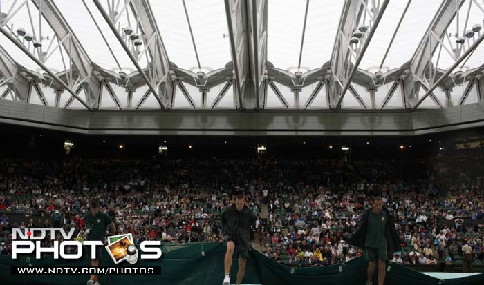 Play was halted for some time during the day as rains forced the roof to shut over the center court but it was only a brief interruption.