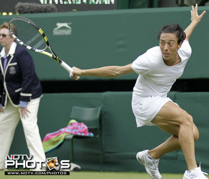 Italy's Francesca Schiavone returns a shot to Australia's Jelena Dokic on her way to a 6-4, 1-6, 6-3 victory.