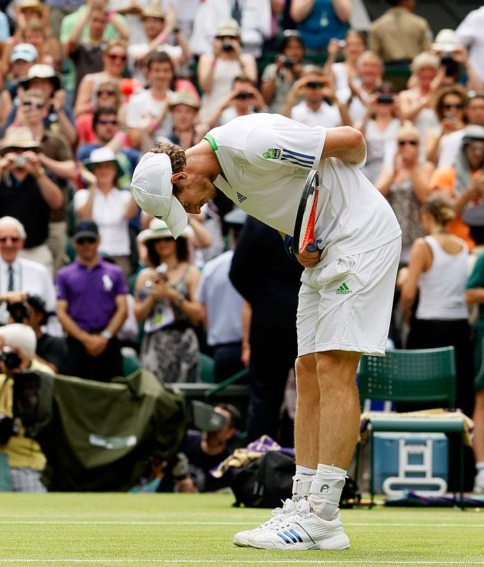 Murray bows to the crowd after defeating France's Richard Gasquet in their match at the All England Lawn Tennis Championships.