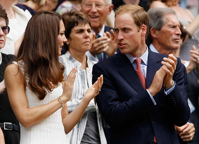 Britain's Duke and Duchess of Cambridge applaud the end of the match.