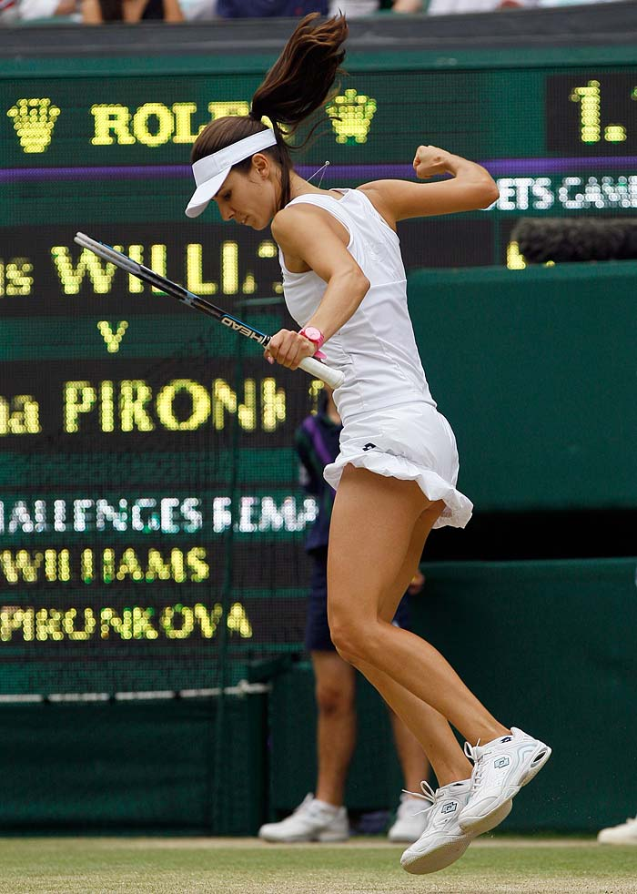 Pironkova celebrates defeating Venus Williams of the US in their match at the All England Lawn Tennis Championships.