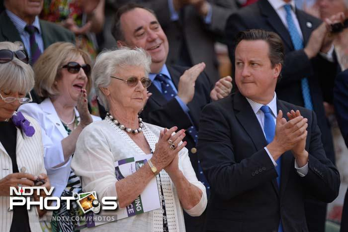 British Prime Minister David Cameron (R) and his mother Mary (2L) stand in the royal box in front of Scotland's First Minister Alex Salmond (2R) and his wife Moira (L).