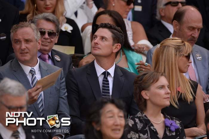 South African-born English golfer Justin Rose (C) enjoys the final from royal box