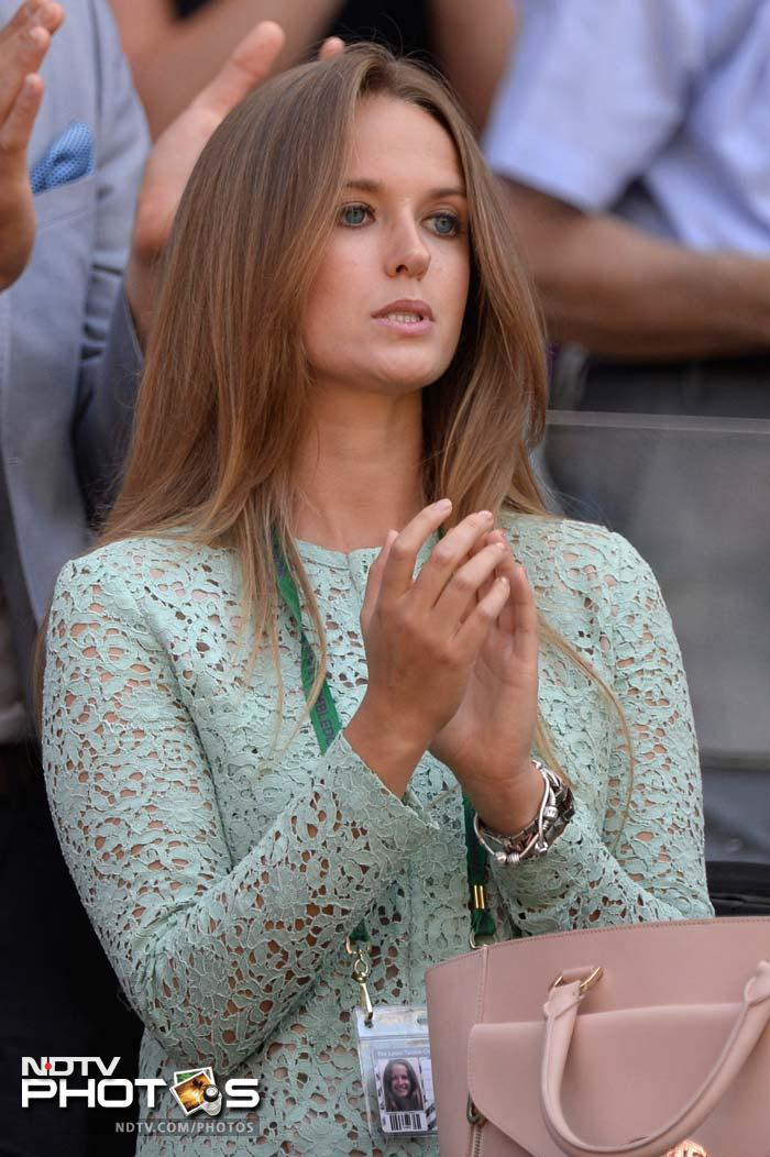 Kim Sears, girlfriend of Britain's Andy Murray, celebrates after world number two won a point against Novak Djokovic.
