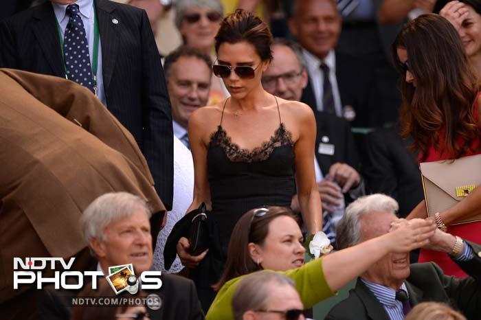 Football legend David Beckham's fashion designer wife Victoria Beckham before the start of play at the Centre Court.