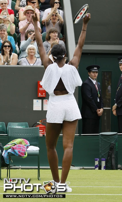 """When asked about her dress, Venus said: """"It's a jumper, and jumpers are very 'now,' as is lace."""" She also liked the draping shoulders, which she called """"in the moment."""" She said: """"It's just kind of like a trendy dress. It's fun."""" (AP Photo)"""
