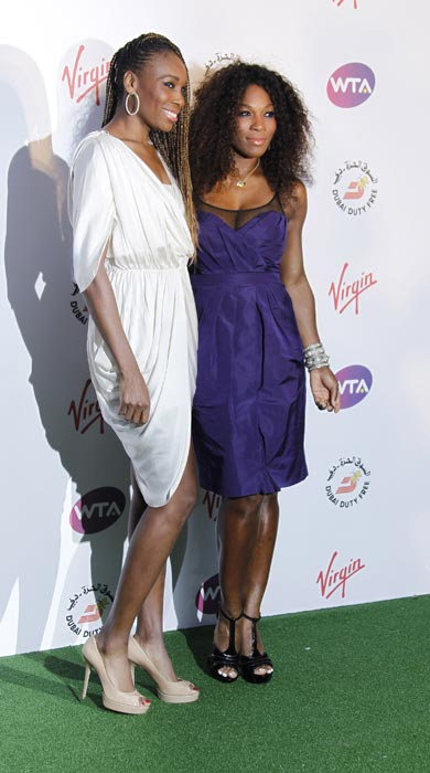 Style sisters Serena and Venus pose at the Pre-Wimbledon Party. (AP Photo)<br><br>Coming Up: Style Divas of Wimbledon.