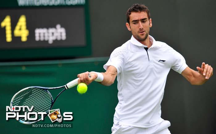 Croatian 10th seed Marin Cilic joined the list of Wimbledon's walking wounded on Wednesday when he withdrew with a left knee injury.