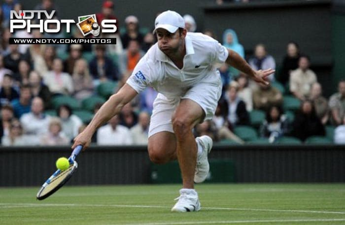 US player Andy Roddick returns the ball during his win to Romanian player Victor Hanescu during their men's single match.