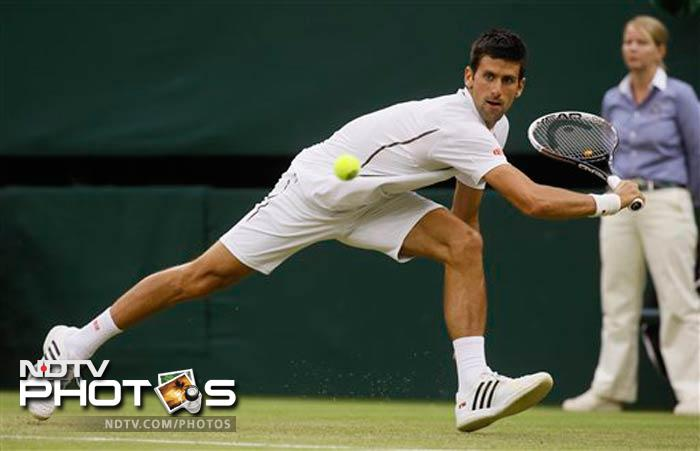 Novak Djokovic avoided becoming the latest star to crash out of Wimbledon as the world number one recovered from a slow start to defeat American qualifier Bobby Reynolds 7-6 (7/2), 6-3, 6-1 in the second round.