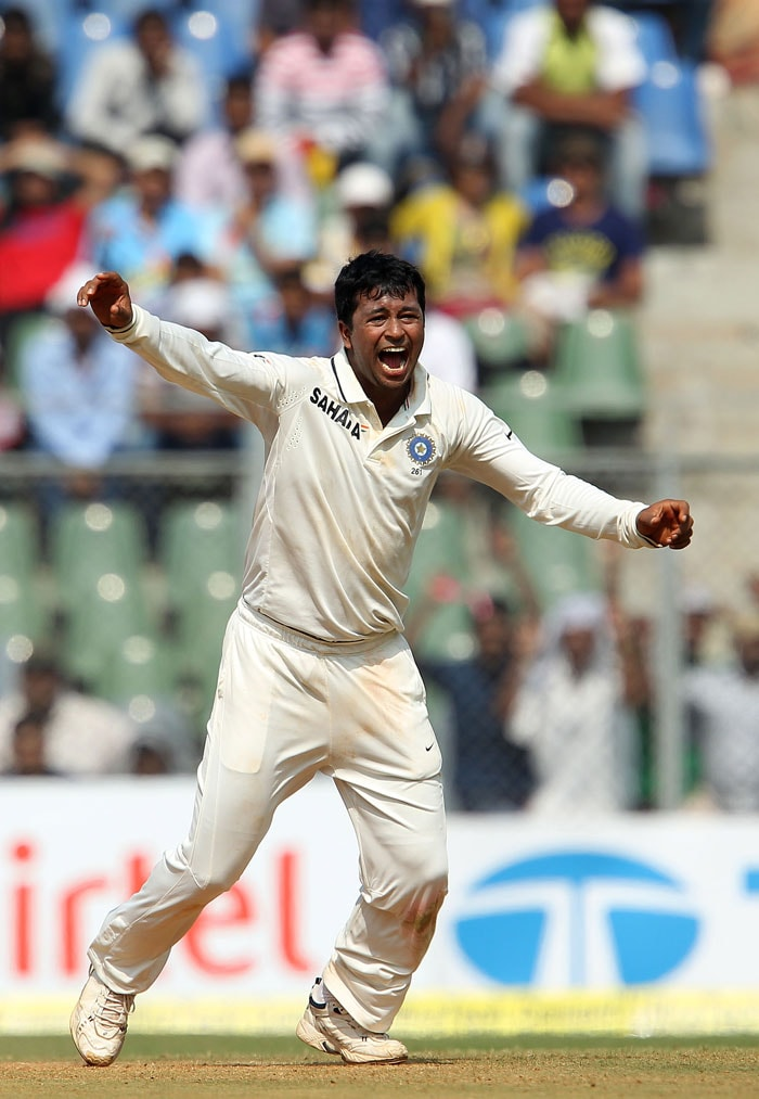 It was only controlled bowling from Pragyan Ojha that ultimately restricted England a lead of 86 runs as the left armer took 5 wickets to have 14 in the series so far. (BCCI Photo)