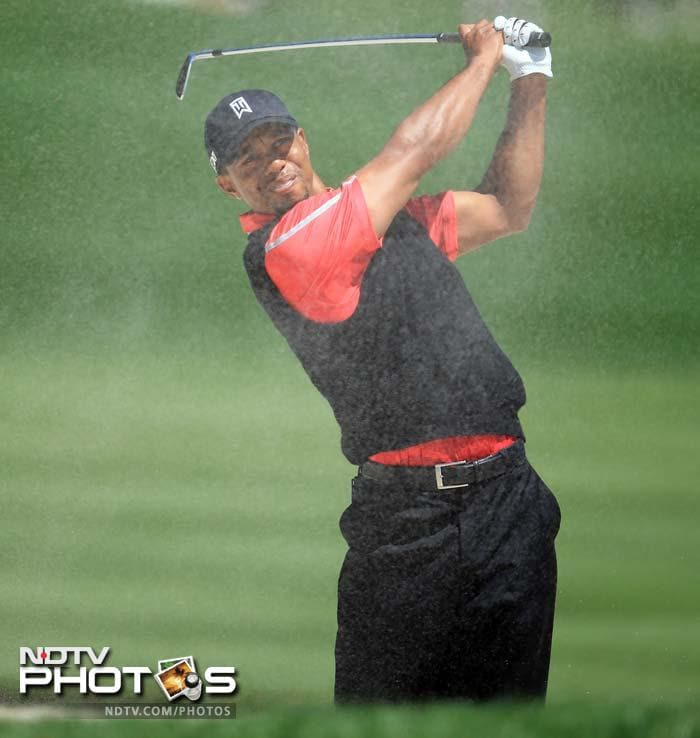 Tiger Woods of the United States plays his second shot at the par 5, 16th hole during the final round of the 2013 Arnold Palmer Invitational at Bay Hill.