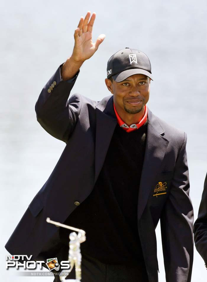 Tiger Woods waves to fans after winning the Arnold Palmer Invitational on March 25, 2013. This was his 77th PGA Tour win that took him to the top of world rankings.