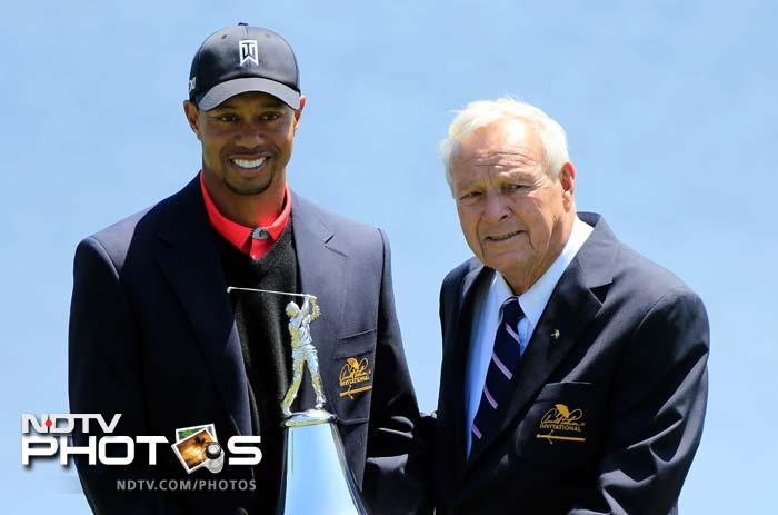 Tiger Woods being presented the Arnold Palmer Invitational trophy during the ceremony by Arnold Palmer at Bay Hill on March 25, 2013.