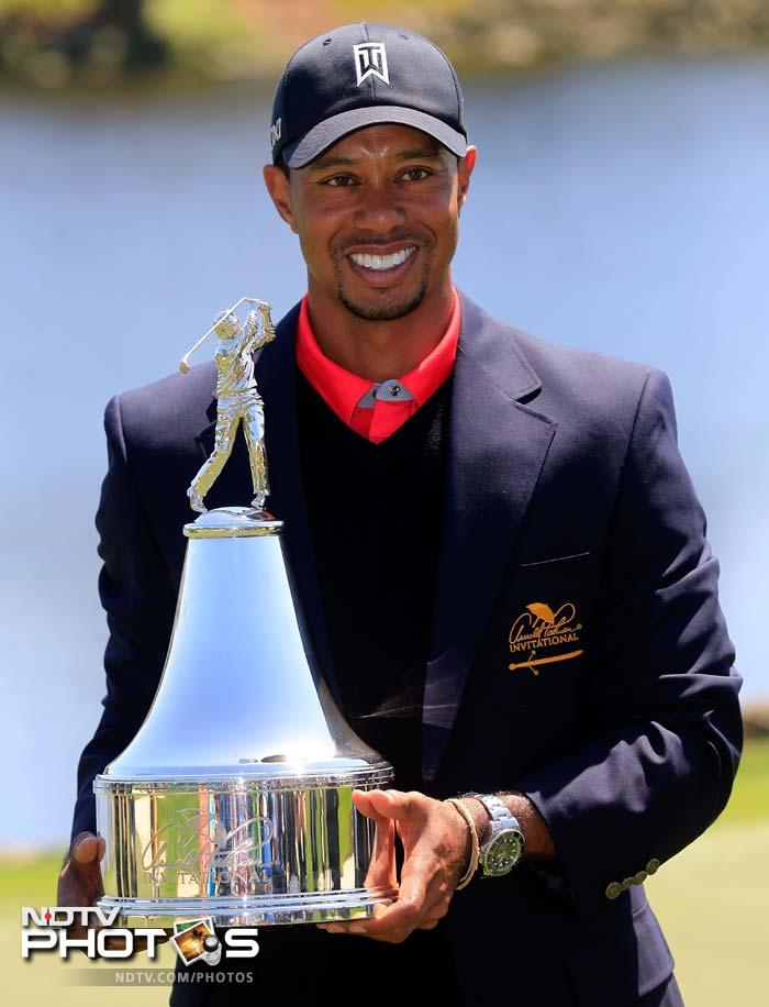 Tiger Woods holds the trophy after winning the Arnold Palmer Invitational at the Bay Hill Club and Lodge on March 25, 2013 in Orlando, Florida.