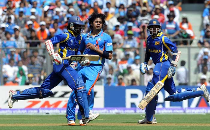 Sri Lankan openers cross over after playing a shot as S Sreesanth looks on. (AFP Photo)