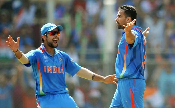 Zaheer Khan gestures after picking up Sri Lanka batsman Upul Tharanga. (AFP Photo)